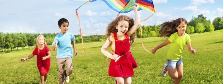 Kids run with kite